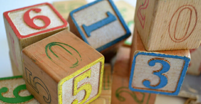 numbered wooden cubes loosely stacked