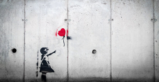 photo of banksy artwork girl letting go of red baloon