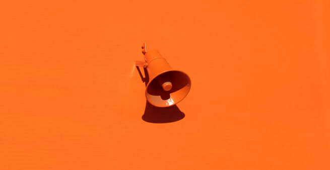 loud haler in orange on orange background